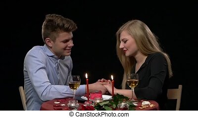 Portrait of beautiful couple enjoying each other's company in a romantic dinner. Close up, Slow motion