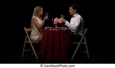 Portrait of beautiful couple enjoying each other's company in a romantic dinner. Slow motion