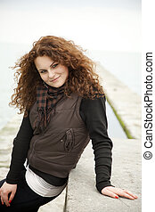 Portrait of beautiful curly teen girl at outdoor.