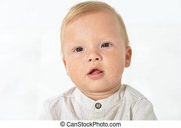 Portrait of beautiful cute baby boy in studio
