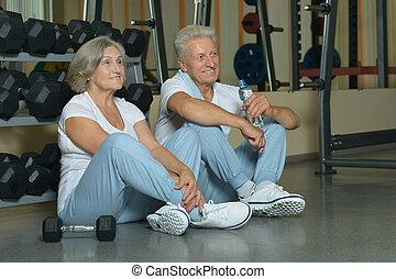 beautiful elderly couple in gym