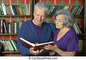 elderly couple reading