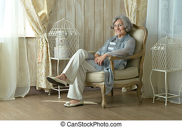 elderly woman on chair in vintage room