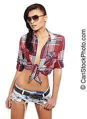 portrait of beautiful fashion sexy brunette girl in jeans and colorful shirt in glasses isolated on white