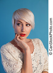 Portrait of beautiful fashionable woman blonde with blue eyes