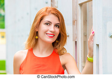 portrait of beautiful girl close-up against a wall in the park