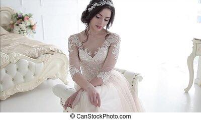 Portrait of beautiful girl in a luxurious wedding dress....