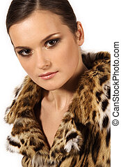Portrait of beautiful girl in a fur coat