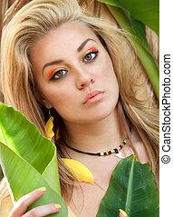 Portrait of Beautiful girl in bananas plantation