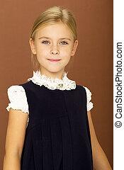 Portrait of beautiful girl in school uniform