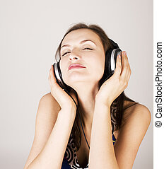 portrait of beautiful girl in headphones, listening music, singing a song isolated on white, lifestyle people concept