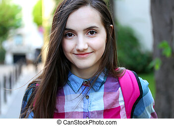 Portrait of beautiful girl in the city