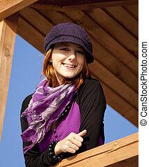 Portrait of beautiful girl in violet cap