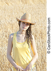 Portrait of beautiful girl in wheat field