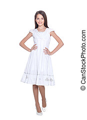 Portrait of beautiful girl in white dress posing on white background