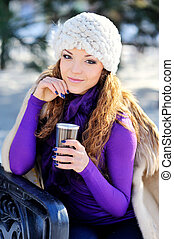 Portrait of beautiful girl in winter with coffee