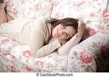 portrait of beautiful girl laying on sofa