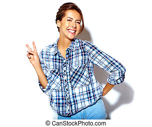 Portrait of beautiful girl model in casual summer checkered shirt with no makeup on white background showing peace sign