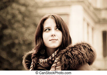Portrait of beautiful girl. Photo in old yellow style.