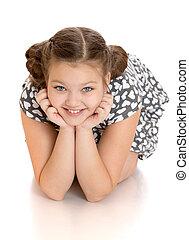 Portrait of beautiful girl sitting on the floor