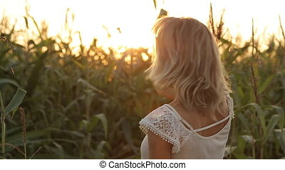 Portrait of beautiful girl smiling at sunset