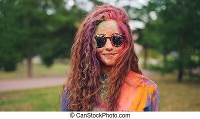 Portrait of beautiful girl wearing sunglasses standing...