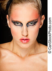 Portrait of beautiful girl with extravagant makeup