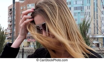 Portrait of beautiful girl with long blonde hair fly in the wind