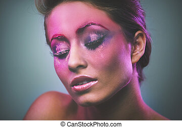 portrait of beautiful girl with pink makeup