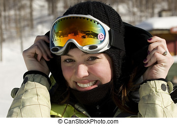 Blond kid girl winter portrait with ski snow goggles and wool hat. f46a6fc88e4f