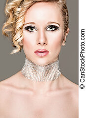 Portrait of beautiful girl with smokey eyes. Retouched - ...