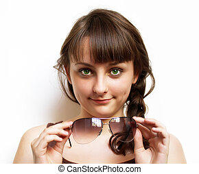 Portrait of beautiful girl with sunglasses on white background.