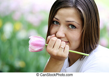 Portrait of beautiful girl with tulip flowers