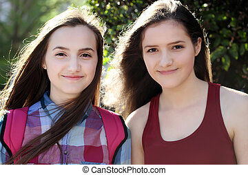 Portrait of beautiful girls in the city