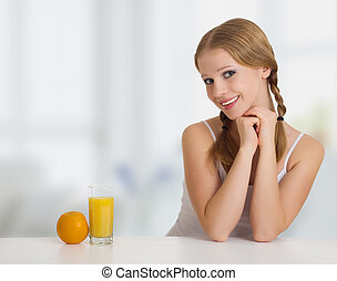 beautiful happy cheerful girl with orange juice