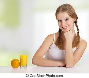 beautiful happy cheerful young woman with orange juice