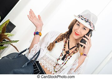 portrait of beautiful hippie girl with smartphone