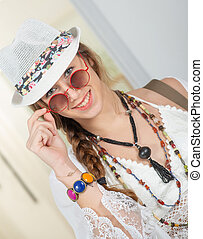 portrait of beautiful hippie girl with white summer hat