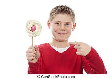 joyful boy with big lollipop