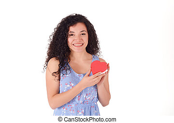 beautiful latin woman, holding red paper hearts.