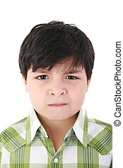 Portrait of beautiful little boy with serious look isolated on white background