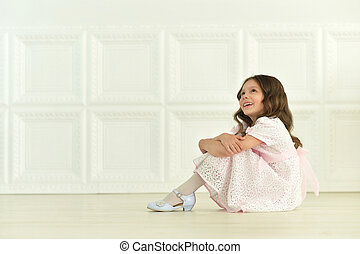 little girl in white dress
