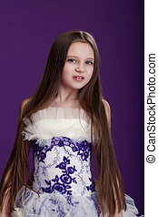 Portrait of beautiful little girl with long hair