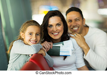 little girl with parents at airport