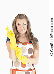 Portrait of beautiful maid with rubber gloves