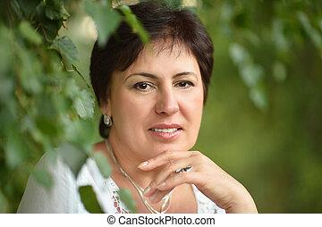 Portrait of beautiful mature woman