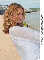 portrait of beautiful mature woman walking outdoors
