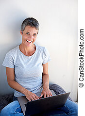 beautiful middle age woman using laptop computer
