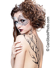 model with skew bodyart - portrait of beautiful model with...