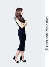 Portrait of beautiful model woman in black dress on white background